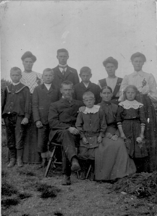 Perhaps somebody was getting married. The Daniel Jonorson family gathered in their  best clothes for what is probably the only family photograph they ever posed for.