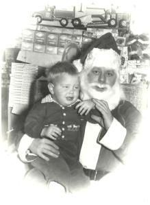The author resists a perplexed Earhart Meyer, acting as the local drugstore Santa Claus in Othello in the late 1950s.