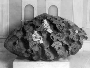 Two visitors recline in the eroded pits on the Willamette Meteorite. The present display at New York's American Museum of Natural History no longer allows such intimacy.