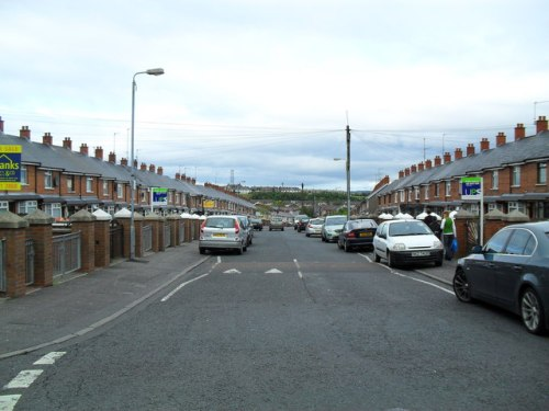 The contemporary view of Ardoyne is cleaner and has more nice cars, but the long blocks of terrace houses look the same.   © Copyright Dean Molyneaux and licensed for reuse under this Creative Commons Licence.