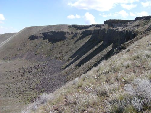 The headscarp of an Ice Age landslide exposes layers of Columbia River basalt and sandstone laid between some of the flows.