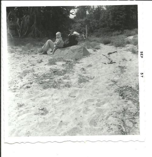 My father and I rest on a sandy bank at Bird Creek Meadows in 1957, when I was a year old.