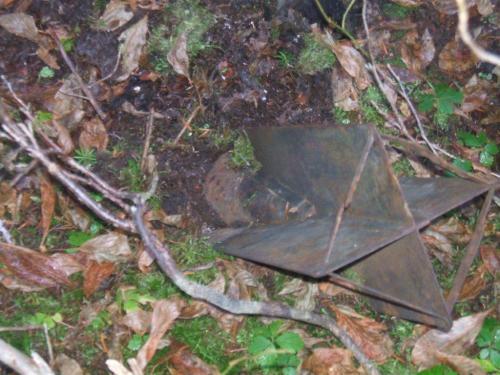The tail of an unexploded Japanese balloon bomb protrudes above the mossy forest floor near Lumy, British Columbia.